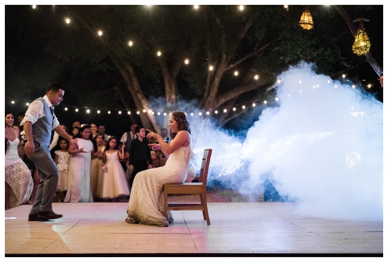 Groom about to give his bride a lap dance at their wedding at Pangas Beach Club in Tamarindo, Costa Rica. Photographed by Kristen M. Brown, Samba to the Sea Photography.