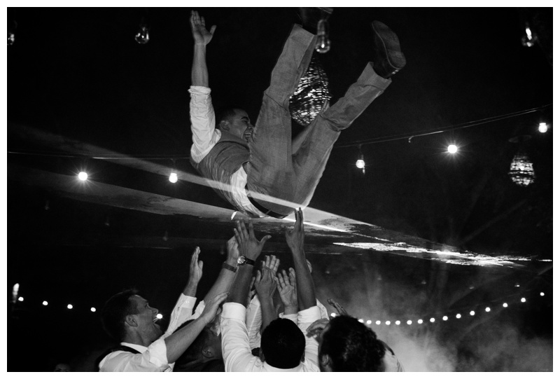 Groom being thrown in the air at his wedding in Tamarindo, Costa Rica.