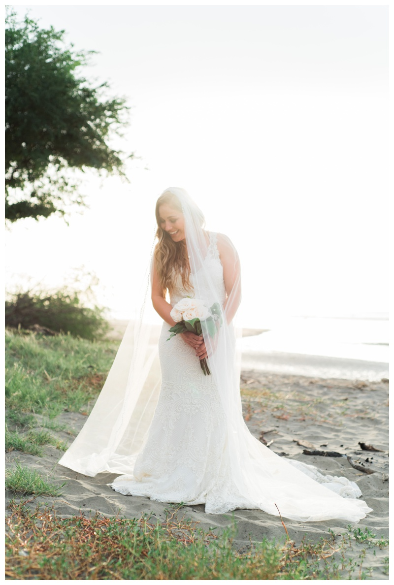 Romantic bridal portrait on the beach in Tamarindo, Costa Rica. Photographed by Kristen M. Brown, Samba to the Sea Photography.