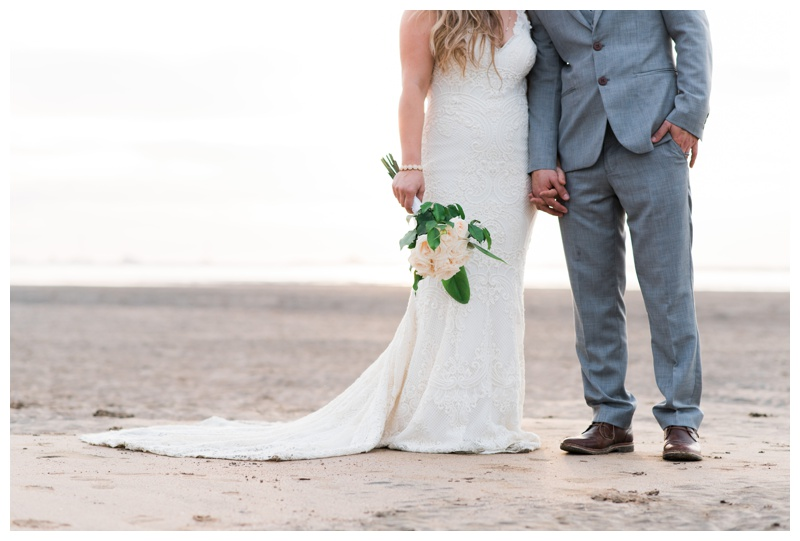 Bride and groom holding hands on the beach in Tamarindo, Costa Rica. Photographed by Kristen M. Brown, Samba to the Sea Photography.