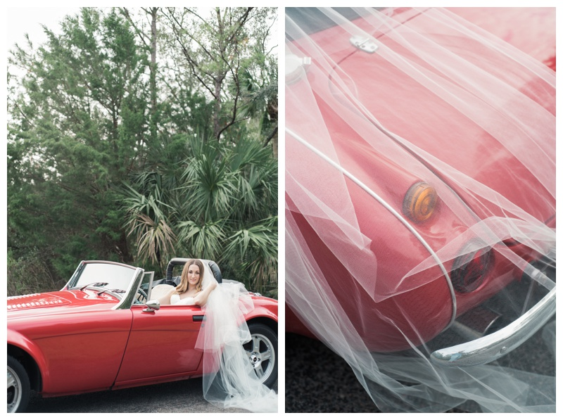 Bride driving a red classic convertible Austin Healey. Bride is wearing a gorgeous dress by Maggie Sottero Designs and veil by Adele Amelia Bridal, available at Ivory & Beau Bridal Boutique in Savannah, GA. Photographed by Kristen M. Brown, Samba to the Sea Photography.