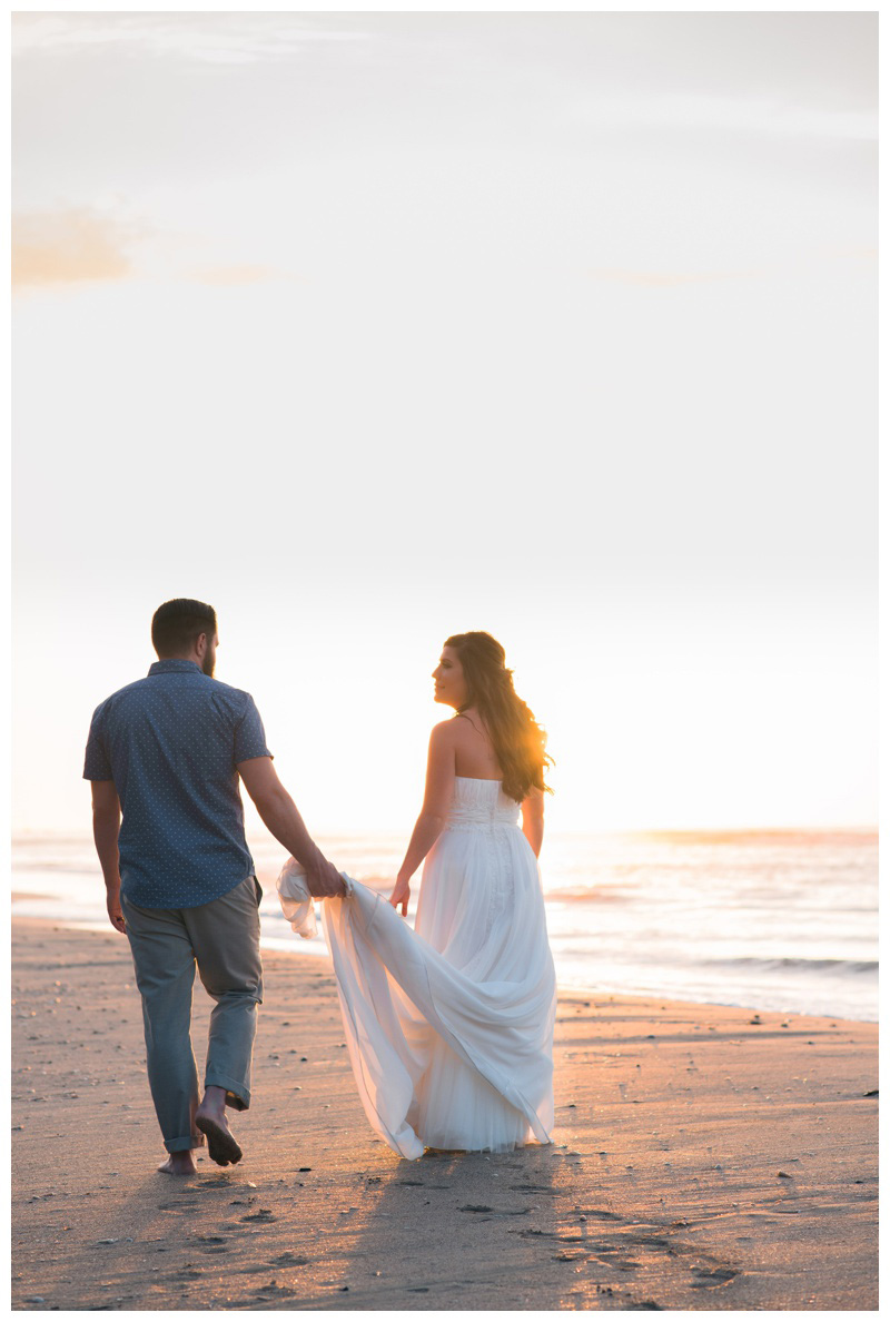 Bride and groom walking on the beach in Tamarindo, Costa Rica during golden hour. Photographed by Kristen M. Brown, Samba to the Sea Photography.