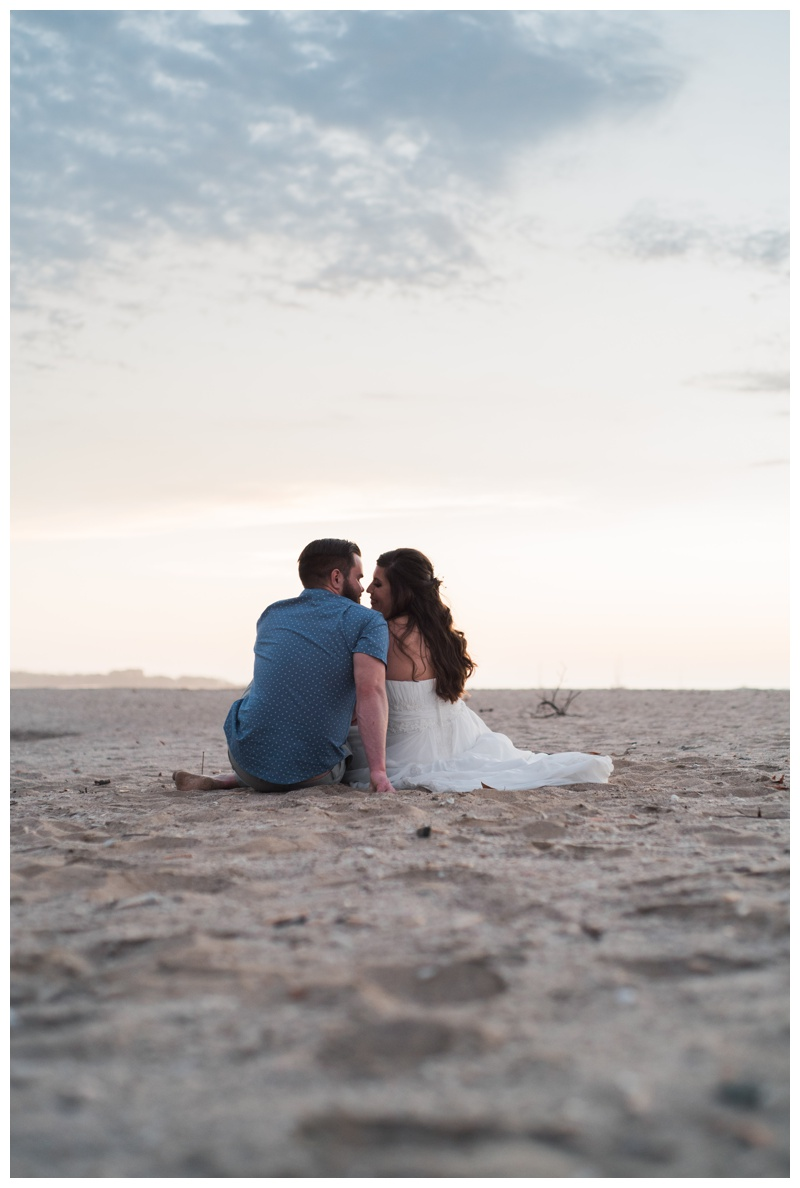 Couple sitting on the beach during sunset in Tamarindo, Costa Rica. Photographed by Kristen M. Brown, Samba to the Sea Photography.