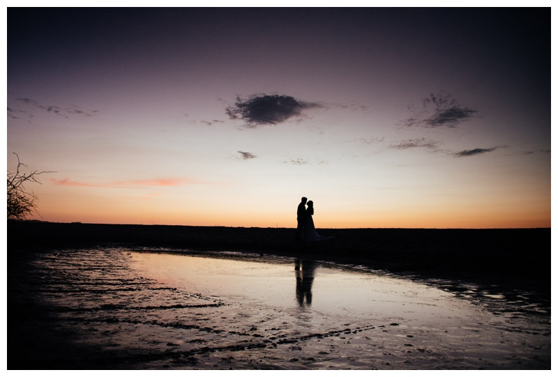 Beautiful silhouette of married couple on the sand in Tamarindo, Costa Rica. Photographed by Kristen M. Brown, Samba to the Sea Photography.