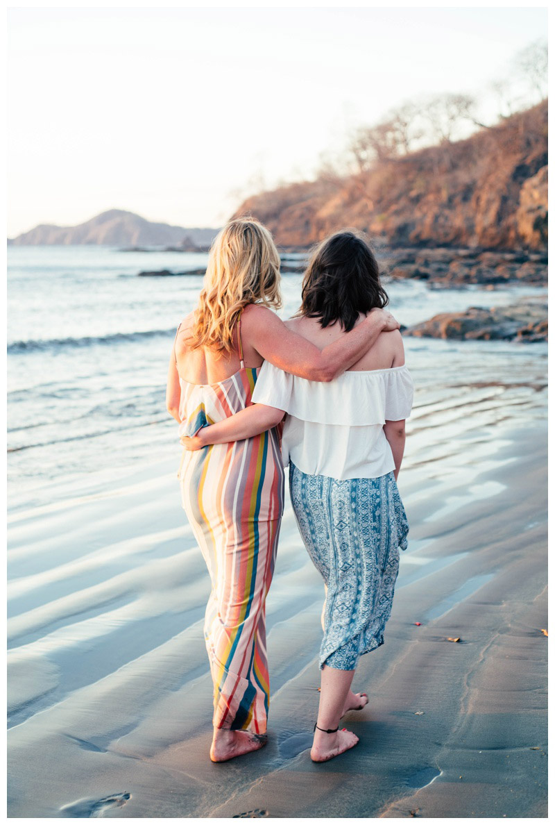 Mother and daughter walking on the beach in Playa Hermosa, Costa Rica. Photographed by Kristen M. Brown, Samba to the Sea Photography.