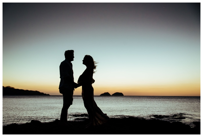 Sunset silhouette of husband and wife in Playa Hermosa, Costa Rica. Photographed by Kristen M. Brown, Samba to the Sea Photography.