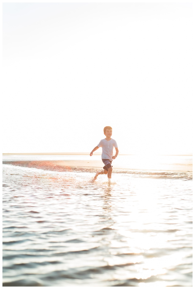 Young boy running on the beach in Tamarindo, Costa Rica. Photographed by Kristen M. Brown, Samba to the Sea Photography.