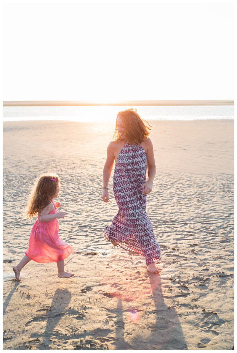 Mother and daughter running on the beach in Tamarindo, Costa Rica. Photographed by Kristen M. Brown, Samba to the Sea Photography.