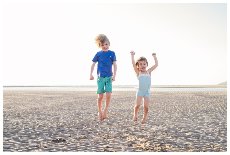 Children jumping on the beach in Tamarindo, Costa Rica. Photographed by Kristen M. Brown, Samba to the Sea Photography.