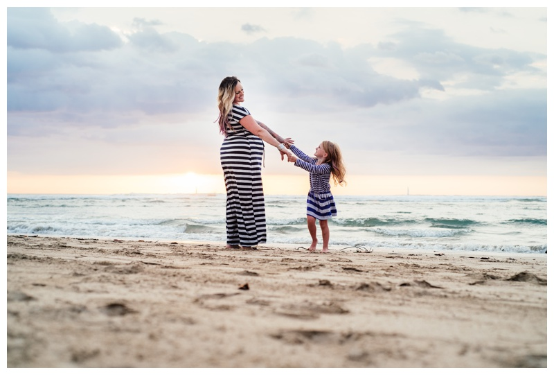 Mom and young daughter twirling on the beach in Tamarindo, Costa Rica, Photographed by Kristen M. Brown, Samba to the Sea Photography.