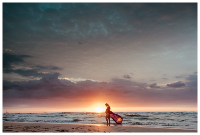 Pregnant mother silhouette during a gorgeous sunset in Tamarindo, Costa Rica. Photographed by Kristen M. Brown, Samba to the Sea Photography.