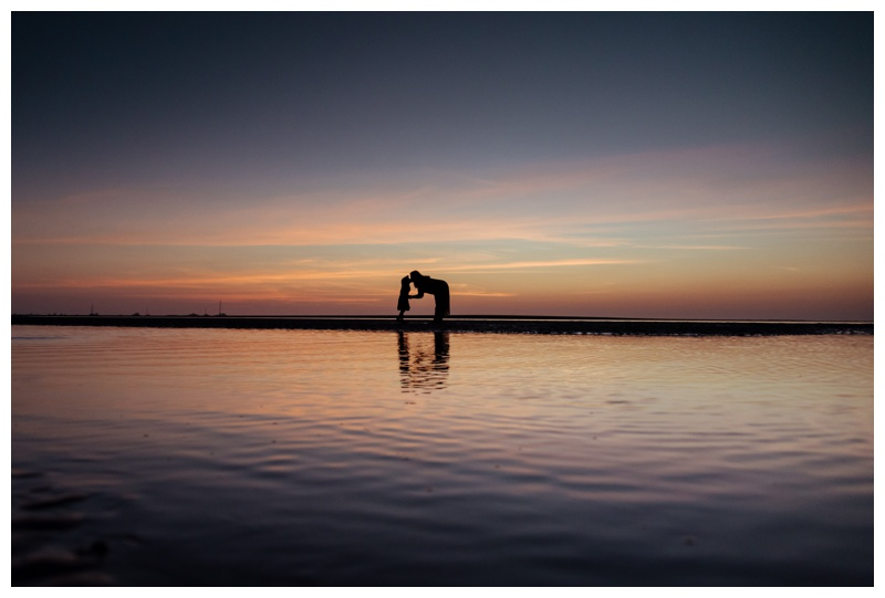 Silhouette of mother and daughter during a gorgeous sunset in Tamarindo, Costa Rica. Photographed by Kristen M. Brown, Samba to the Sea Photography.