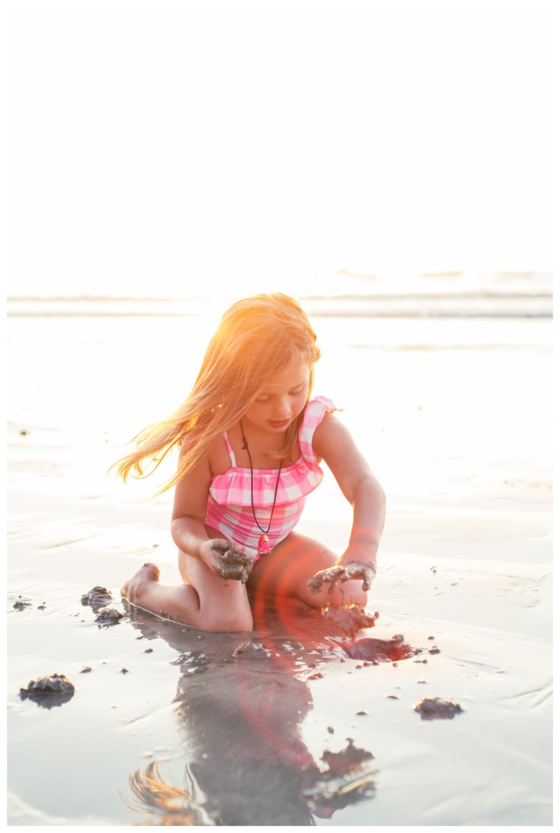 Young girl playing in the sand in Tamarindo, Costa Rica. Photographed by Kristen M. Brown, Samba to the Sea Photography.