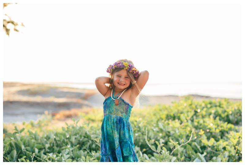 Portrait of young girl on the beach in Tamarindo, Costa Rica. Photographed by Kristen M. Brown, Samba to the Sea Photography.