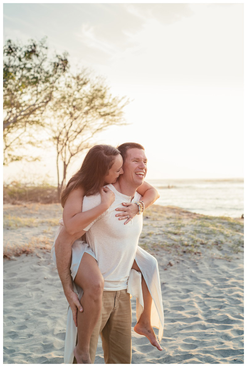Couple embracing on the beach in Tamarindo, Costa Rica. Photographed by Kristen M. Brown, Samba to the Sea Photography.