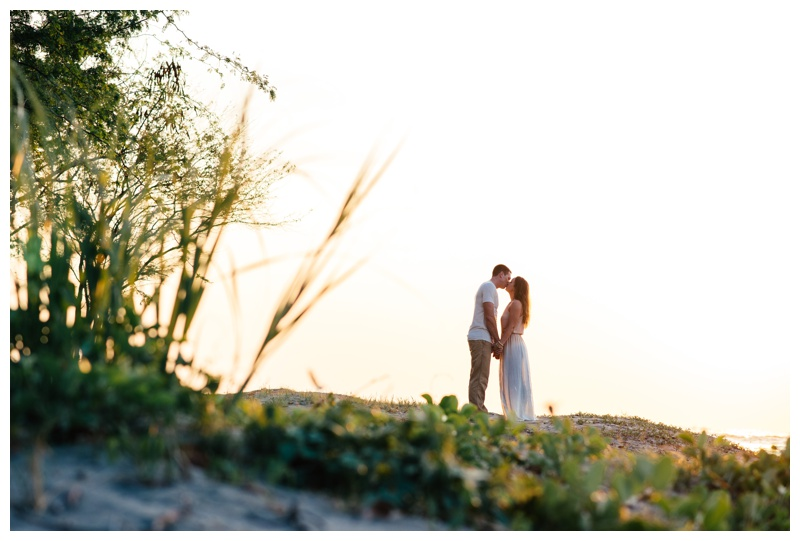 Couple kissing on the beach in Tamarindo, Costa Rica. Photographed by Kristen M. Brown, Samba to the Sea Photography.