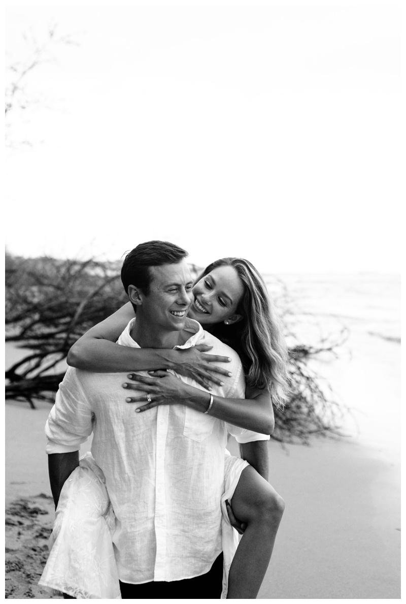 Husband giving his wife a piggy back ride on the beach in Tamarindo, Costa Rica. Photographed by Kristen M. Brown, Samba to the Sea Photography.