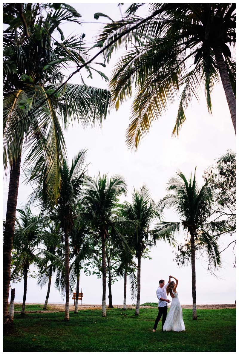 Husband dancing with his wife in a palm tree grove in Tamarindo, Costa Rica. Photographed by Kristen M. Brown, Samba to the Sea Photography.