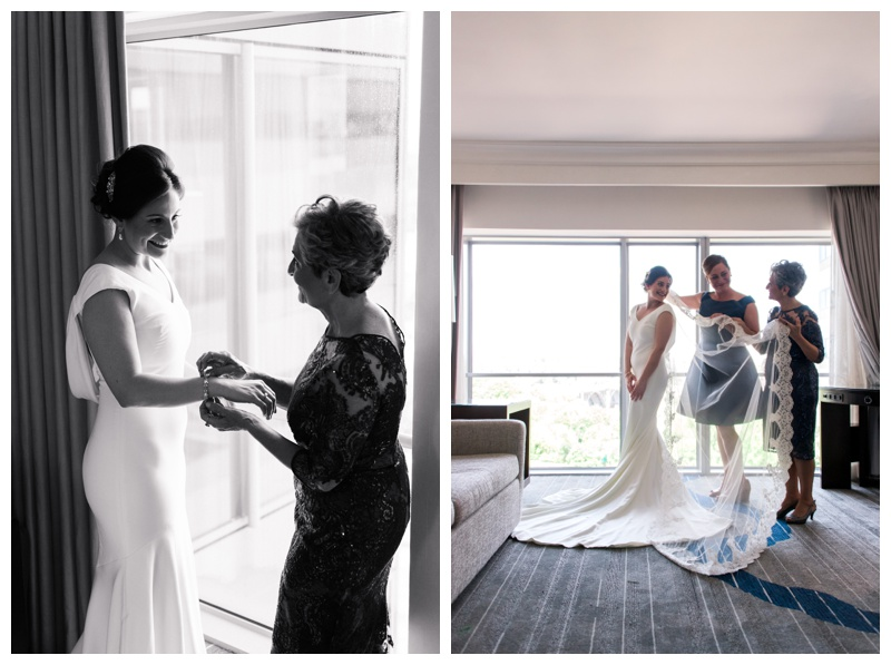Bride getting ready with her mom and sister at Le Meridien in Arlington, VA. Photographed by Kristen M. Brown, Samba to the Sea Photography.