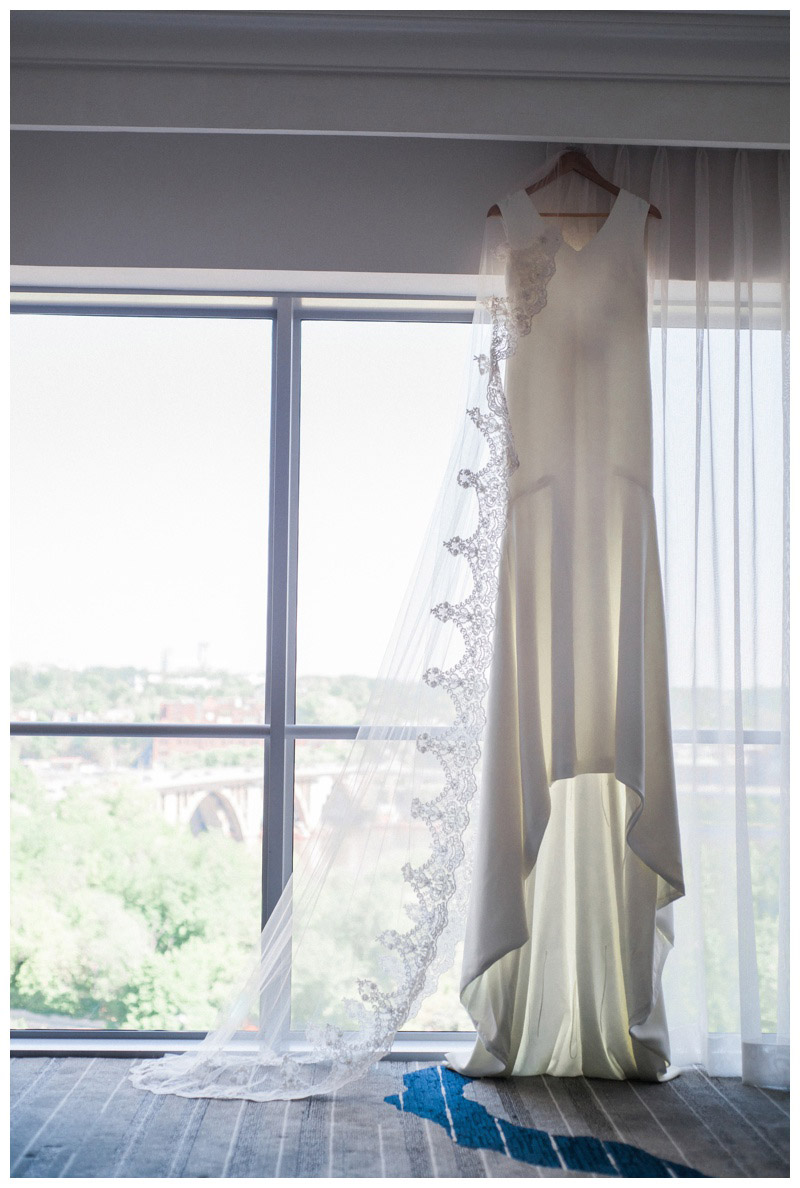 Wedding dress with a view of Georgetown at Le Meridien in Arlington, VA. Photographed by Kristen M. Brown, Samba to the Sea Photography.