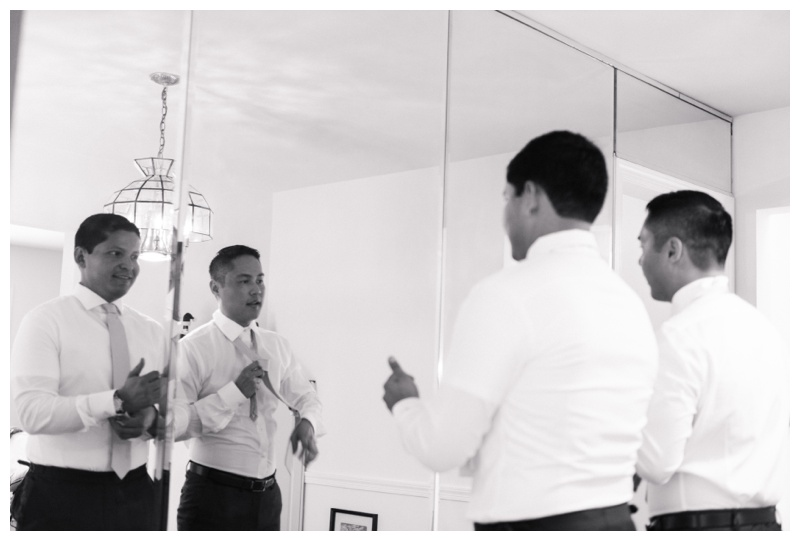 Groom and best man getting ready. Photographed by Kristen M. Brown, Samba to the Sea Photography.