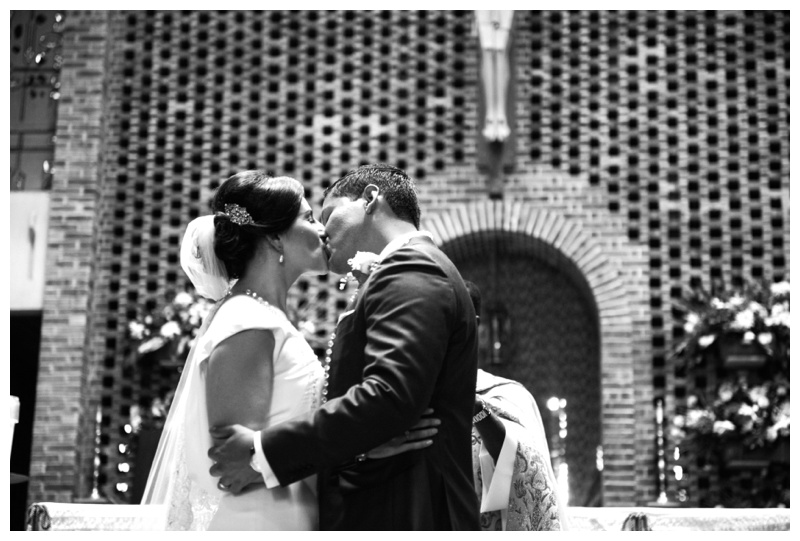 Bride and Groom first kiss at St. Anthony Padua. Photographed by Kristen M. Brown, Samba to the Sea Photography.