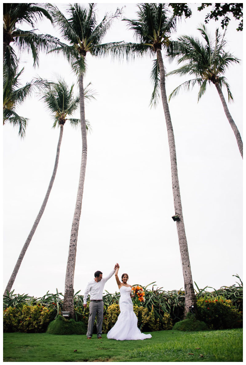Groom spinning his bride under a palm tree grove in Tamarindo, Costa Rica. Photographed by Kristen M. Brown, Samba to the Sea Photography.