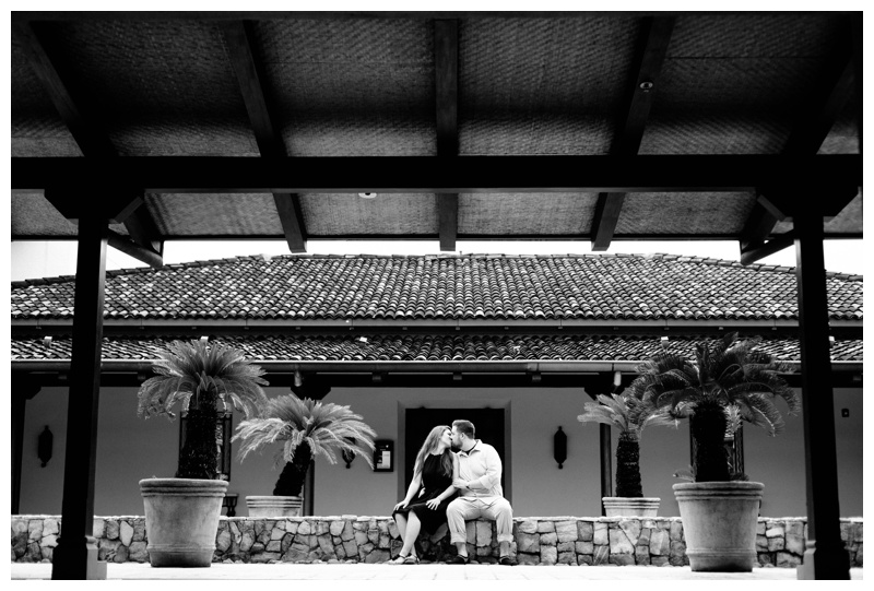 Couple kissing in a Spanish courtyard in Costa Rica. Photographed by Kristen M. Brown, Samba to the Sea Photography.