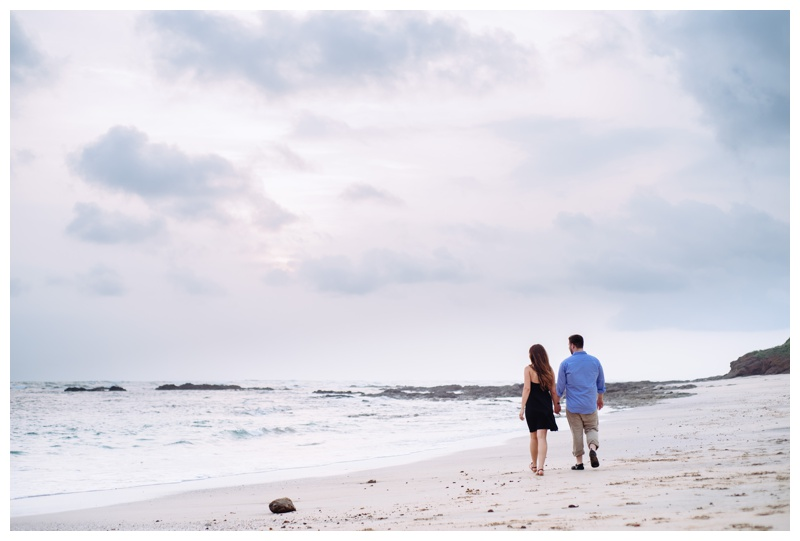 Couple walking on the beach at Hacienda Pinilla. Photographed by Kristen M. Brown, Samba to the Sea Photography.