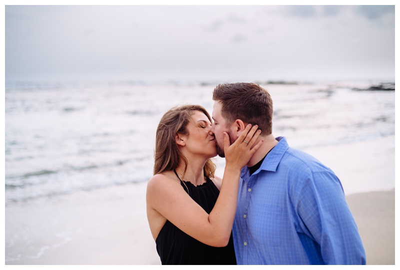 Couple kissing on the beach at Hacienda Pinilla in Costa Rica. Photographed by Kristen M. Brown, Samba to the Sea Photography.