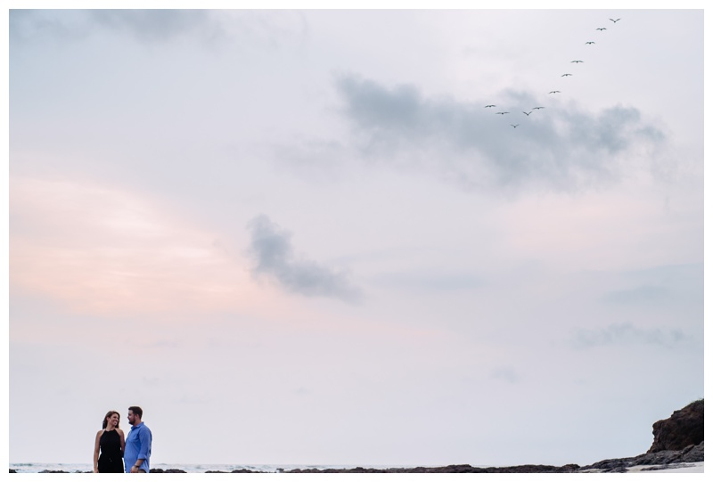 Couple on the beach in Costa Rica. Photographed by Kristen M. Brown, Samba to the Sea Photography.