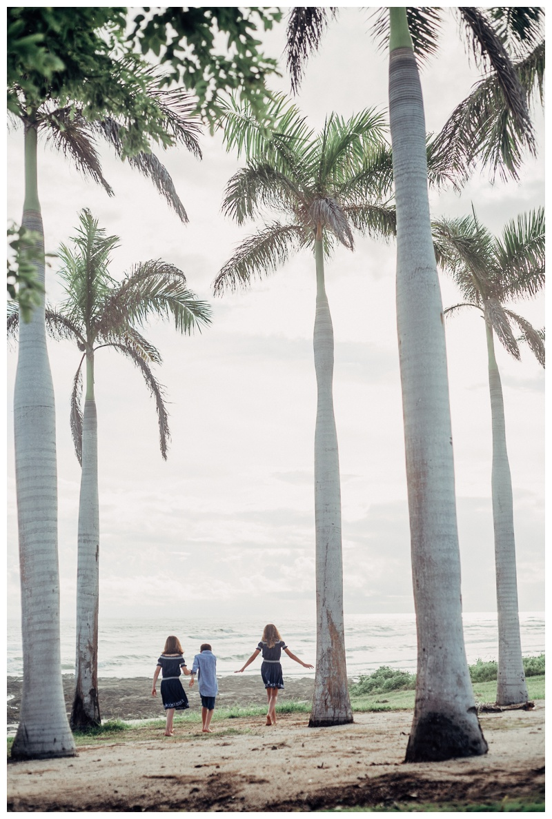 Children running through a palm tree grove at Hacienda Pinilla Costa Rica. Photographed by Kristen M. Brown, Samba to the Sea Photography.