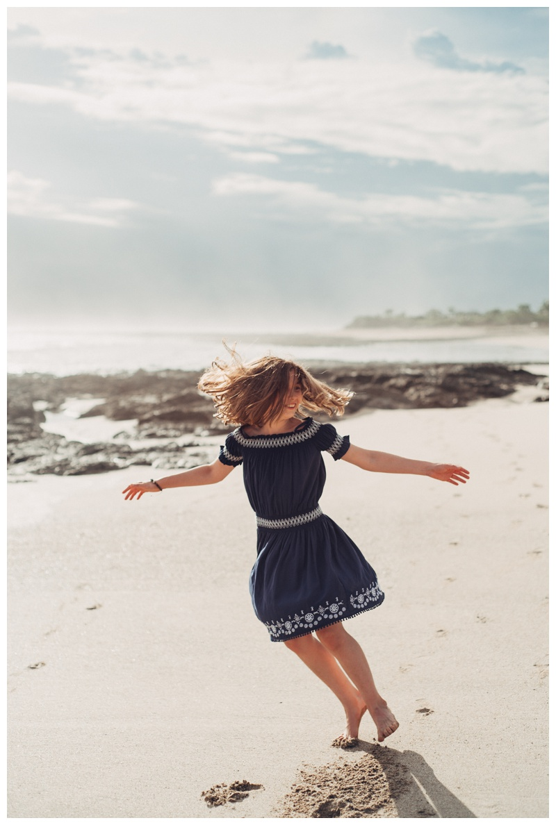 Girl dancing on the beach in Playa Avellanas Costa Rica. Photographed by Kristen M. Brown, Samba to the Sea Photography.