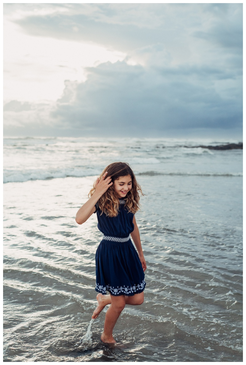 Girl walking on the beach in Playa Avellanas Costa Rica. Photographed by Kristen M. Brown, Samba to the Sea Photography.