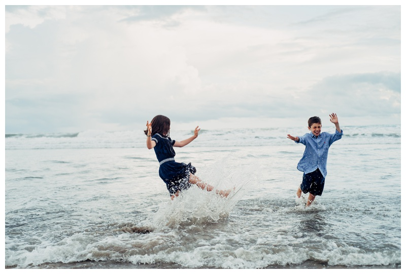 Siblings playing in the ocean at Playa Avellanas Costa Rica. Photographed by Kristen M. Brown, Samba to the Sea Photography.