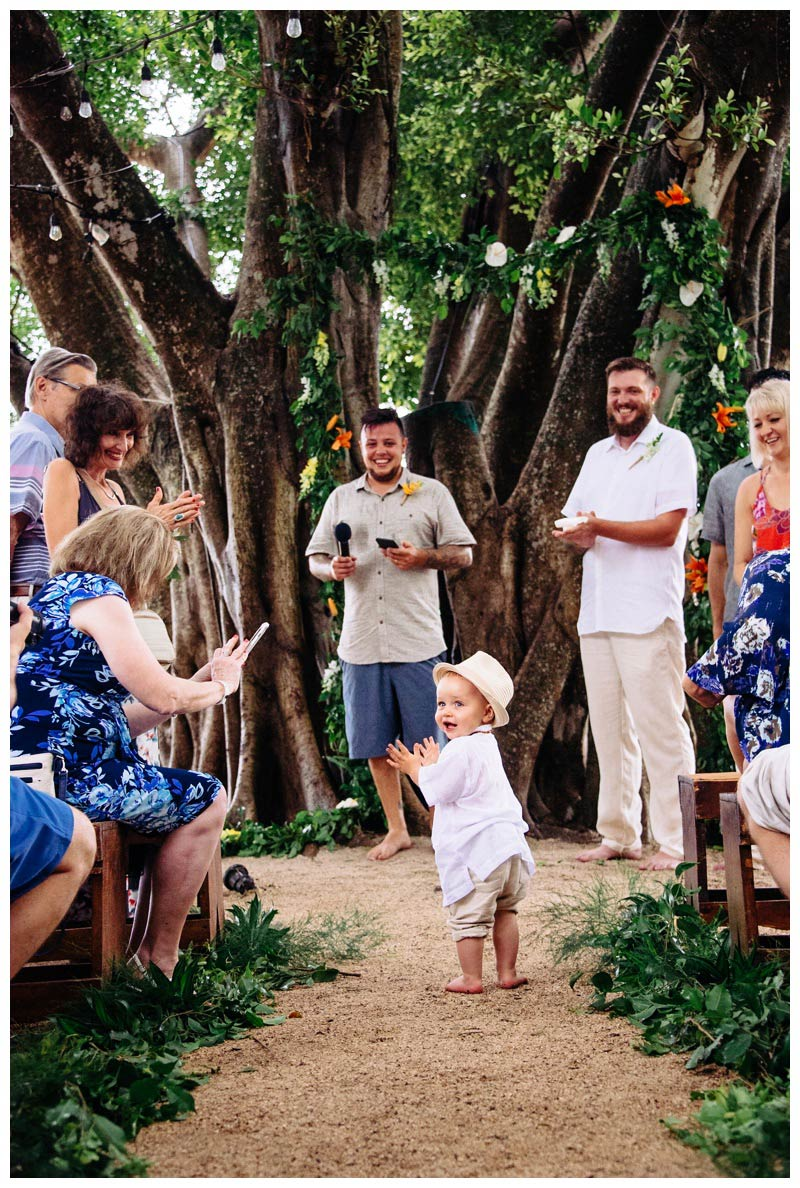 Ring bearer clapping as he walks down the aisle at wedding in Tamarindo Costa Rica .Photographed by Kristen M. Brown, Samba to the Sea Photography.