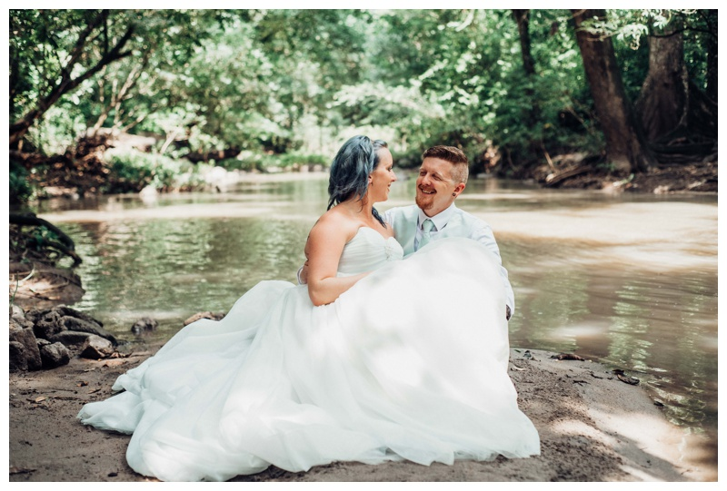 Wedding under a waterfall in Costa Rica at Llanos de Cortes waterfall. Intimate Costa Rica waterfall elopement. Bride is wearing a Disney Wedding Dress by Alfred Angelo. Photographed by Kristen M. Brown, Samba to the Sea Photography.