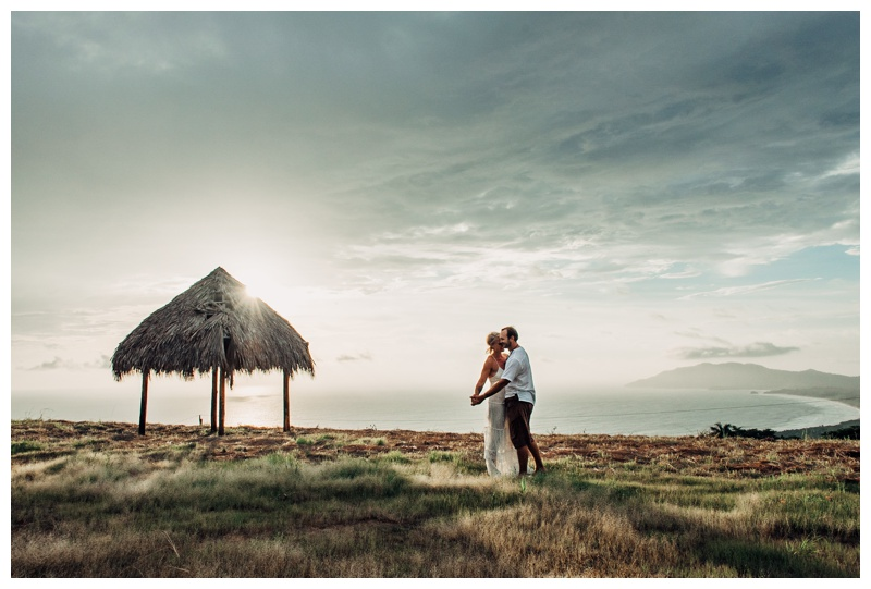 Bride and groom dancing after their elopement with the most beautiful view of the Pacific Ocean in Costa Rica. Photographed by Kristen M. Brown, Samba to the Sea Photography.