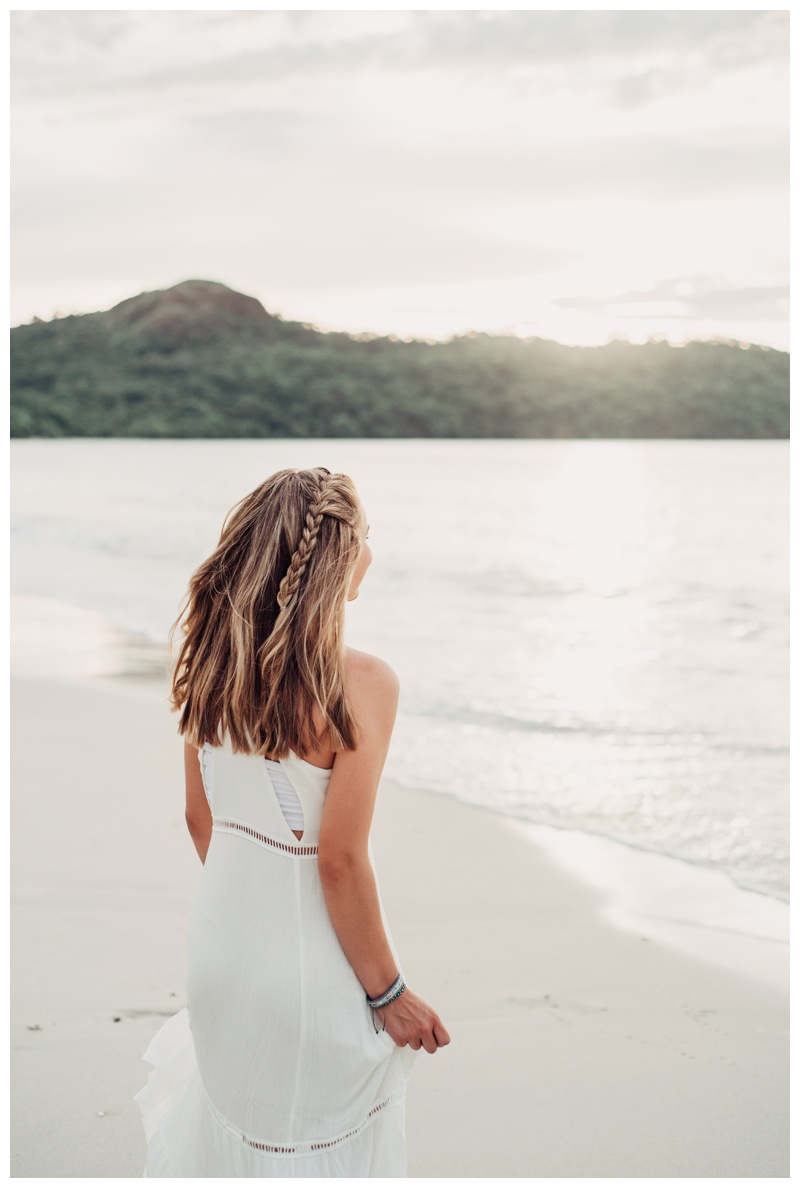Beautiful side braid for senior photos in Costa Rica. Girl playing on the beach in Playa Conchal Costa Rica. Photographed by Kristen M. Brown, Samba to the Sea Photography.