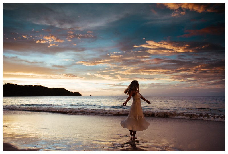 Girl playing in the ocean during a gorgeous sunset in Playa Conchal Costa Rica. Photographed by Kristen M. Brown, Samba to the Sea Photography.