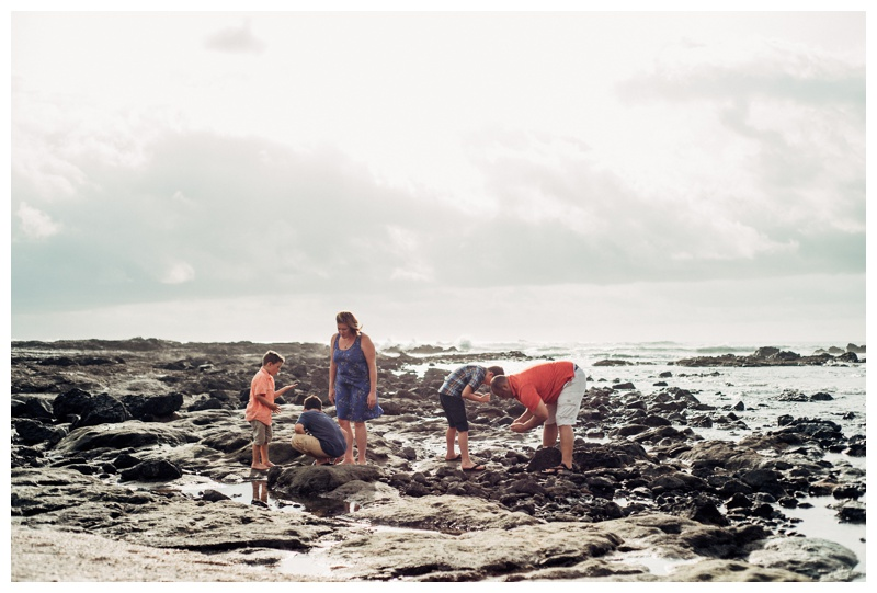Family exploring the low tide pools in Playa Langosta Costa Rica. Photographed by Kristen M. Brown, Samba to the Sea Photography.