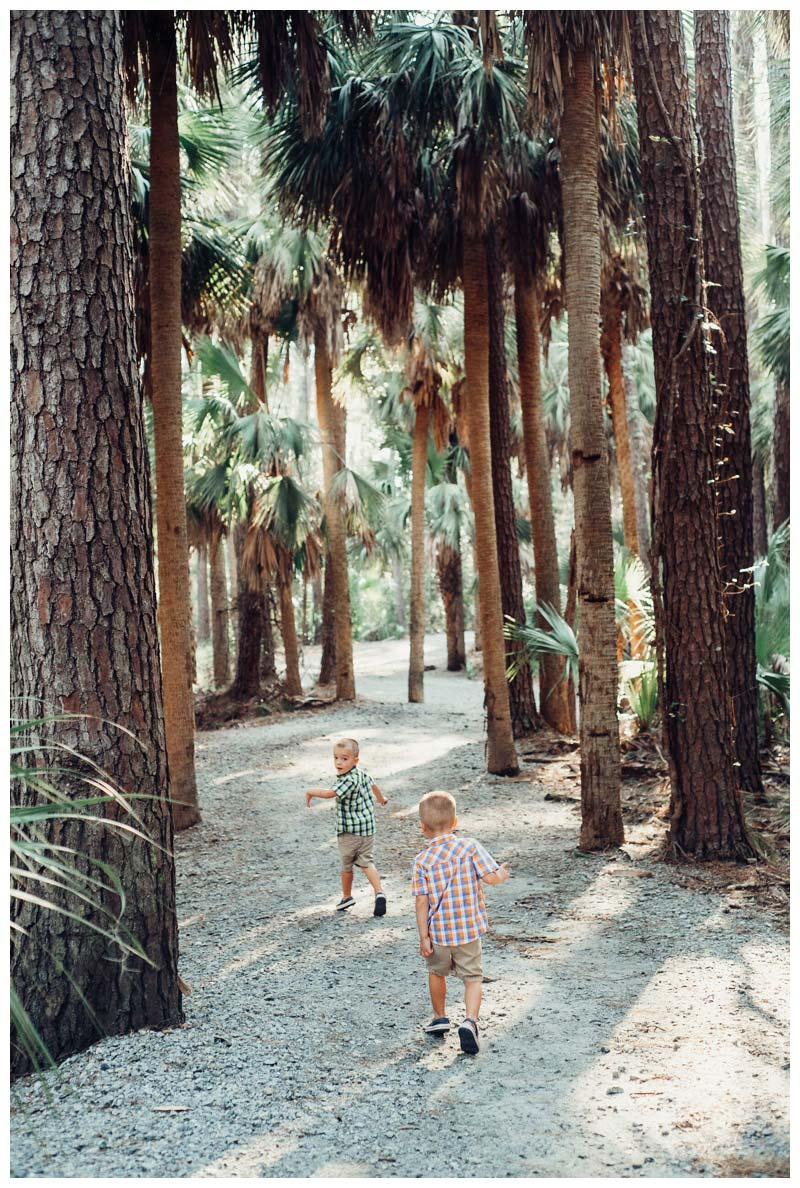 Twin boys running through the Nature Trail at The Landings on Skidaway Island. Definitely on of the best places for family photos on Skidaway Island! Photographed by Kristen M. Brown, Samba to the Sea Photography.