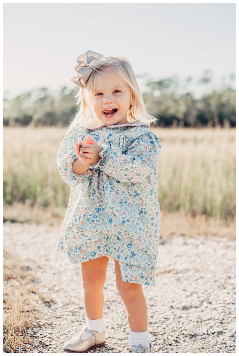 Little girl showing off her oyster shell collection in Savannah GA. Fall family pictures in Savannah Georgia at The Landings on Skidaway Island. Photographed by Kristen M. Brown, Samba to the Sea Photography.