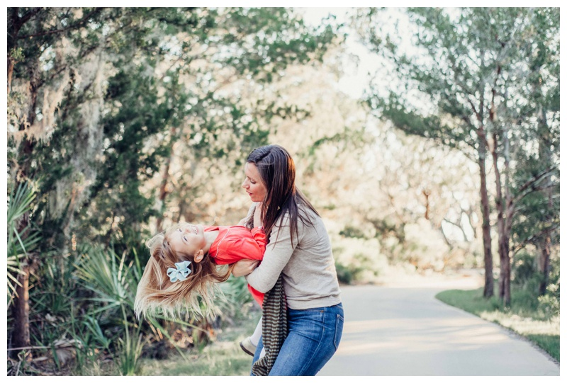 Mother hugging her daughter during family photos. Fall family pictures in Savannah Georgia at The Landings on Skidaway Island. Photographed by Kristen M. Brown, Samba to the Sea Photography.