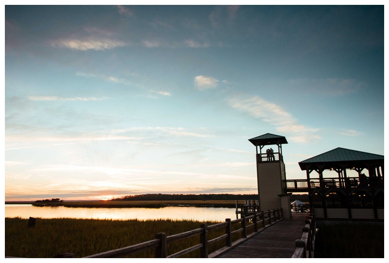 Family watching sunset at Delegal Marina at The Landings in Savannah Georgia. Fall family pictures in Savannah Georgia at The Landings on Skidaway Island. Photographed by Kristen M. Brown, Samba to the Sea Photography.