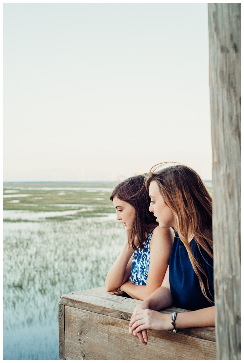 Sisters looking out over the marsh in Savannah Georgia. Photographed by Kristen M. Brown, Samba to the Sea Photography.