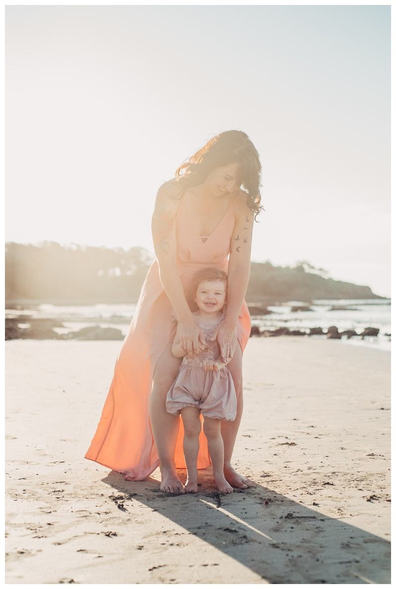 Mother and daughter laughing on the beach in Tamarindo Costa Rica. Photographed by Kristen M. Brown, Samba to the Sea Photography.