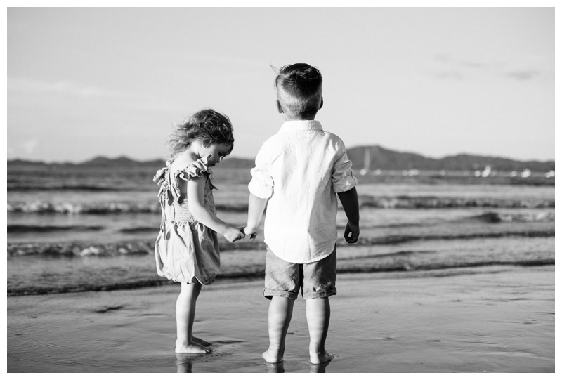 Toddlers holding hands on the beach in Costa Rica. Photographed by Kristen M. Brown, Samba to the Sea Photography.
