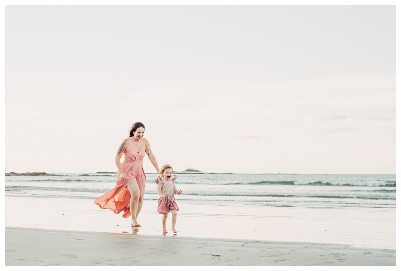 Mother playing her daughter on the beach in Costa Rica. Photographed by Kristen M. Brown, Samba to the Sea Photography.