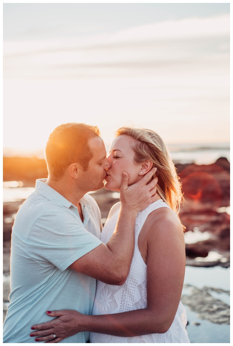 Couple kissing during golden hour in Costa Rica. Photographed by Kristen M. Brown, Samba to the Sea Photography.